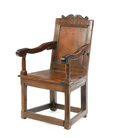 A Charles II oak panelled armchair, initialed ISA, dated 1663