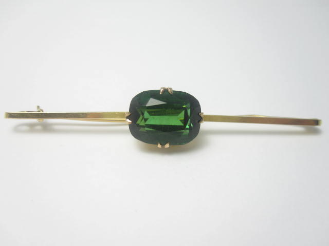 An early 20th century green tourmaline bar brooch