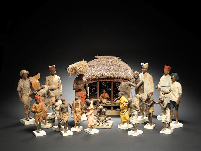 A group of eighteen terracotta and wood figures of tradespeople and a model of a peasant's hut Krishnanagar, Calcutta, 19th Century(19)