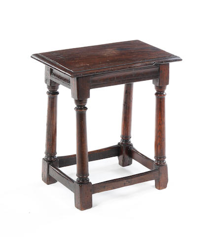 A mid 17th century and later oak stool
