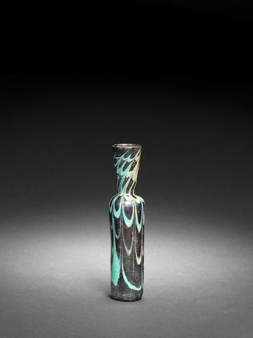 A marvered brown and turquoise glass Vial  Egypt or Syria, 12th-13th Century