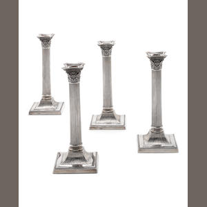 A set of four Edwardian silver Corinthian column candlesticks by Walter Latham & Son,  Sheffield 1911  (4)