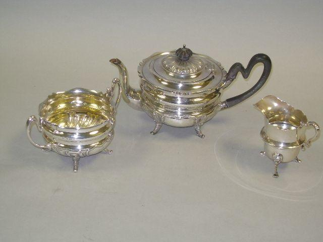 Silver teapot with matching sugar bowl; plus a small jug.(3)