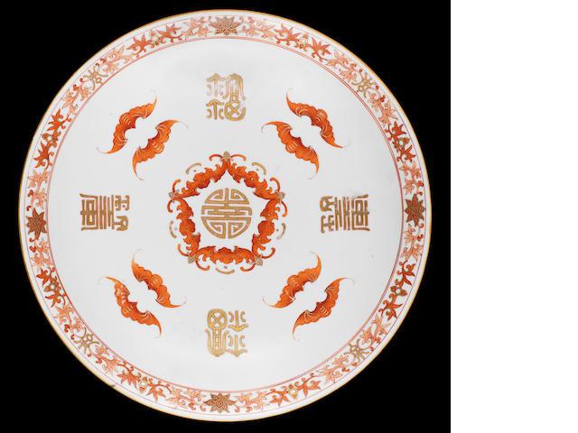 An iron-red and gilt saucer dish 18th century, seal mark Shou shan fu hai