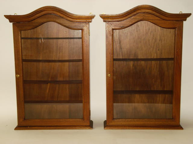 A pair of solid dark wood wall display cabinets,