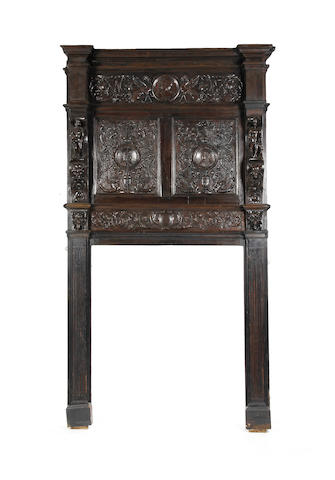A carved oak fire surround incorporating late 16th century Renaissance panels Panels probably French
