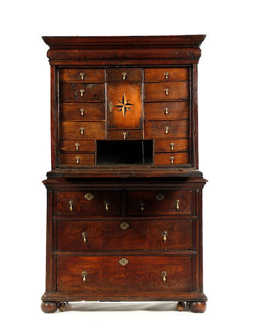 An early 18th century oak escritoire