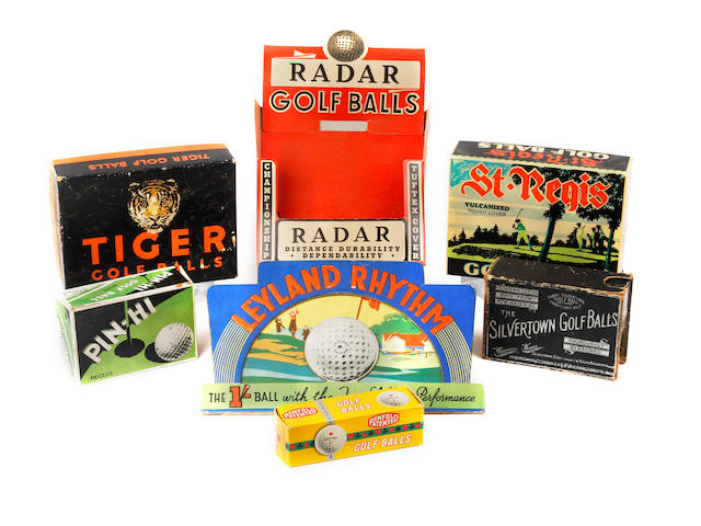 A small collection of empty golf ball boxes