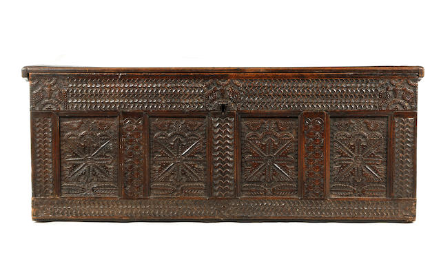 An 18th Century carved oak coffer,