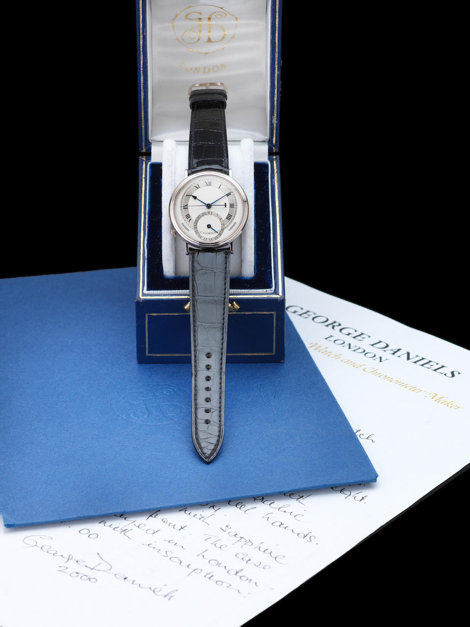 George Daniels. A very fine and rare 18ct white gold automatic calendar centre seconds wristwatch, one of only seven made in white gold, together with original box and receipts, correspondence and 2006 Retrospective Exhibition catalogue signed by Dr George DanielsMillennium, Made in 2000 and Sold November 22nd 2000