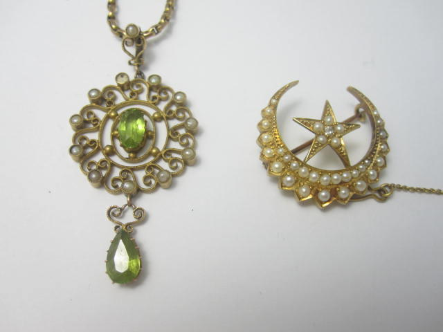An Edwardian pendant and brooch (2)