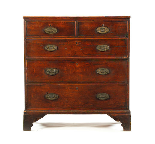 A late George III rectangular oak chest