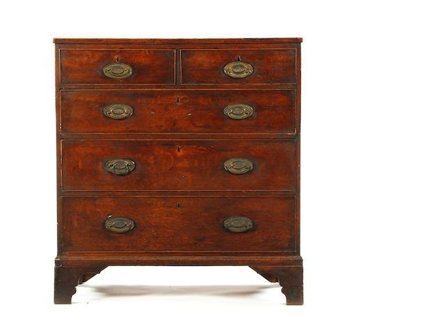 A late George III rectangular oak chest
