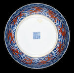 A pair of blue and white and iron-red 'dragon' dishes Qianlong seal marks and of the period