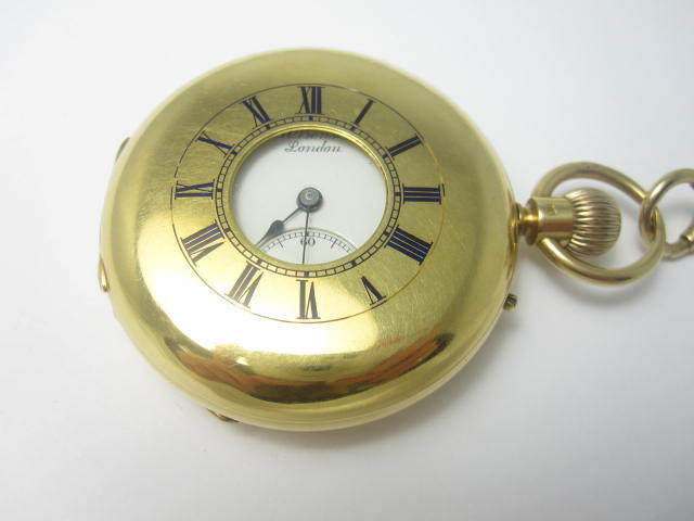 A half hunter pocket watch, by Benson and an Albert watch chain
