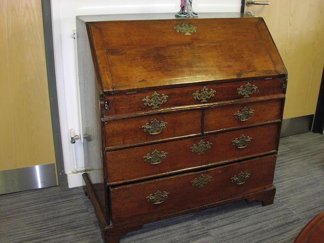 A George III oak bureau,