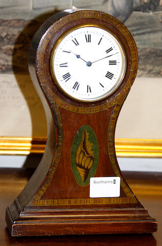 A late 19th Century French mahogany mantel timepiece,