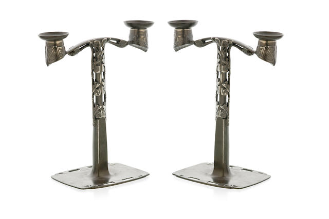 A Pair of Arts & Craft Pewter Candelabra designed by Archibald Knox for Liberty & Co