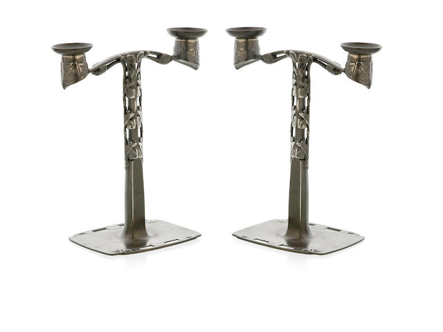 A Pair of Arts & Craft Pewtar Candelabra designed by Archibald Knox for Liberty & Co