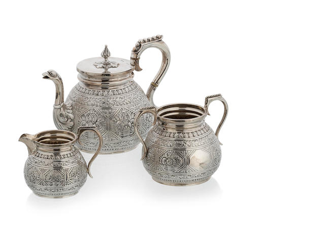 A Victorian silver three piece tea set in the Indian manner by Charles Stuart harris, London 1878