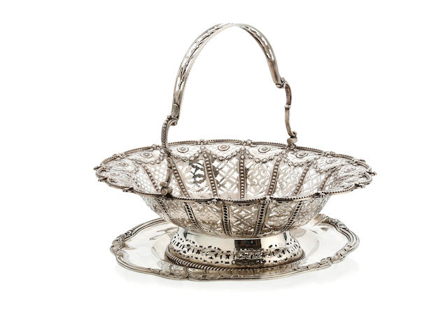 A Victorian silver pierced oval swing handle bread basket by Richard Martin and Ebenezer Hall, Sheffield 1895