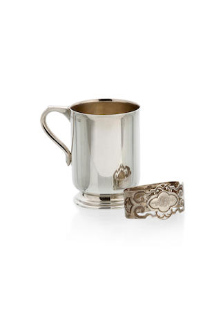 An Australian   silver mug and a pierced napkin ring by Stokes and Son, Melbourne, circa 1950