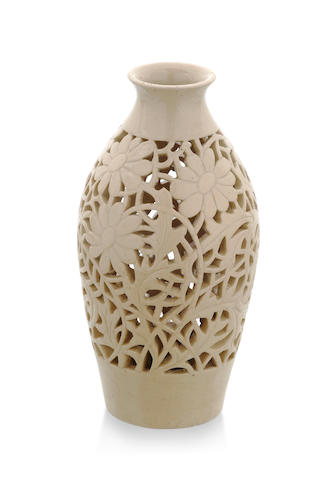 A floral neticulated cream glaze vase by John Castle-Harris