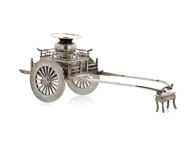 A Japanese silver inkstand in the form of a rickshaw and a rest, marked Made in Silver by Etsu, circa 1900