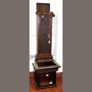 A later carved 18th century oak longcase clock