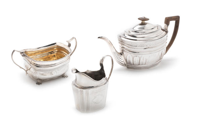 A matched George III silver three-piece tea service the teapot by Duncan Urquhart & Naphtali Hart, London 1802, the jug and sugar dish, maker's marks rubbed, Dublin 1798 and 1813