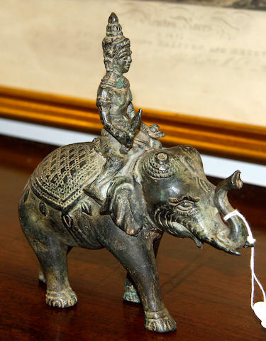 A South East Asian bronze mounted elephant,