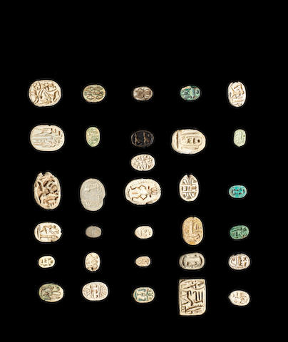 A group of Egyptian steatite and glazed composition scarabs and plaques and six scarabs, 37