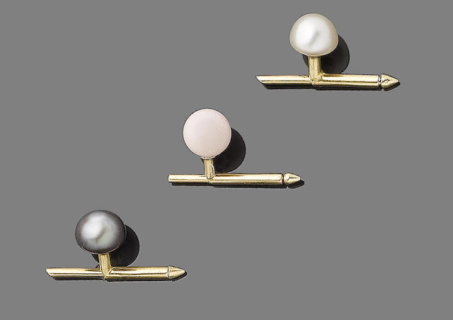 Two natural pearl and a conch shell bead studs (3)