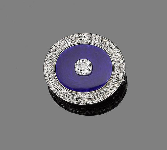 An enamel and diamond brooch,