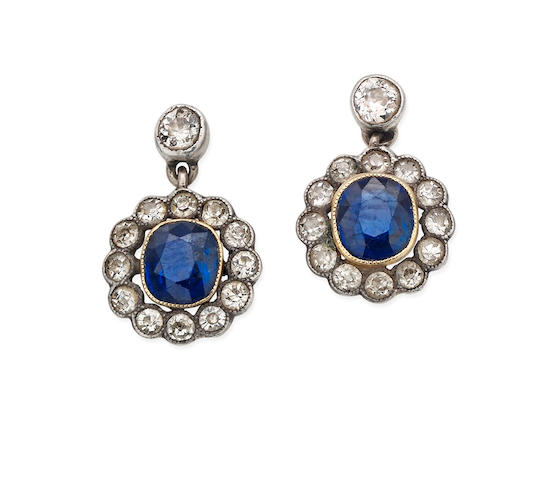 A pair of early 20th century sapphire and diamond cluster earrings