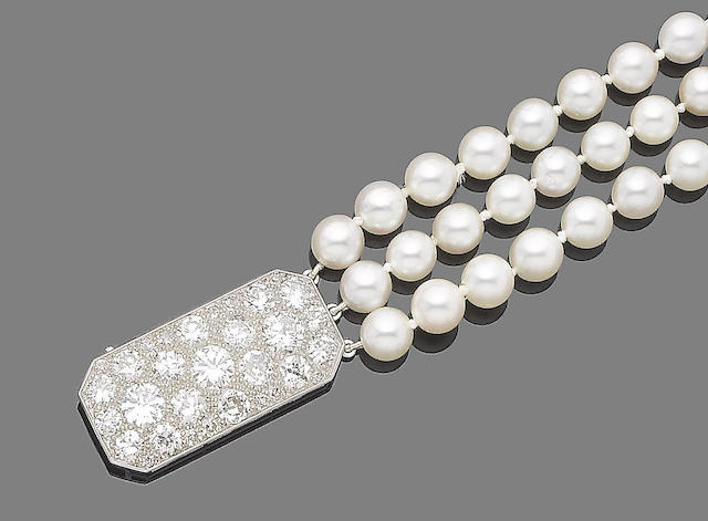 A three-row cultured pearl bracelet and diamond clasp