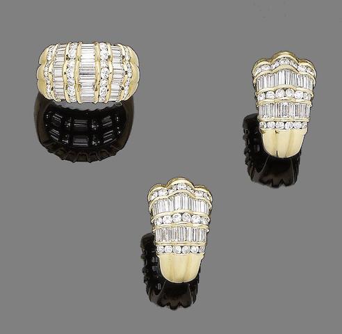 A diamond dress ring and pair of earrings en suite (2)