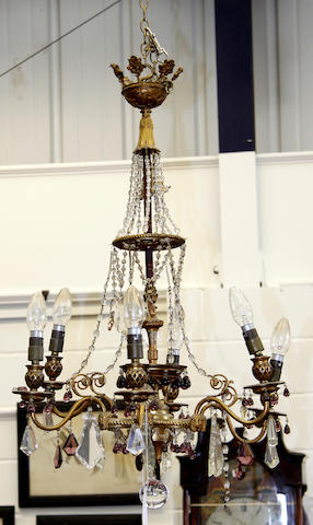 An Empire style gilt metal six branch chandelier