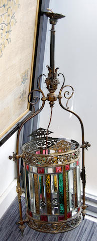 A brass and coloured glass cylindrical hanging lantern
