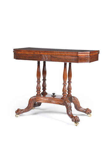 An early 19th Century Federal period carved mahogany tea table in the manner of Duncan Phyfe