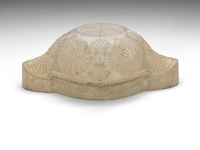 A saltglaze sauceboat block, a turks cap mould and another mould inscribed RW 1755