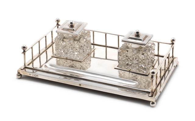 An Edwardian silver two-bottle galleried inkstand by Charles Boyton, London 1902,