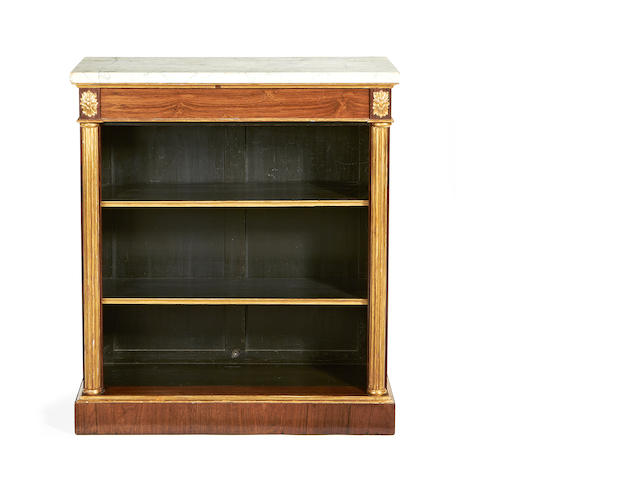 A Regency rosewood and parcel gilt open pier cabinet