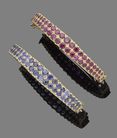 A pair of ruby and sapphire bangles (2)