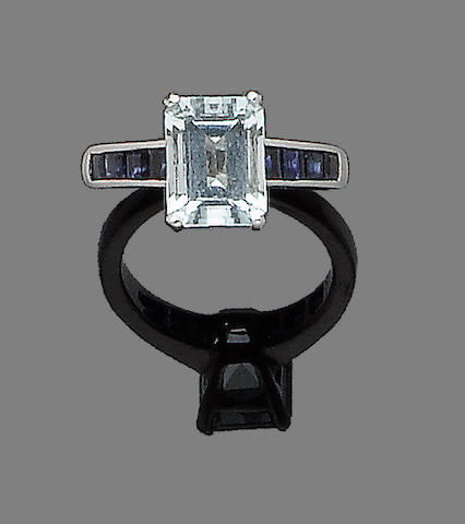 An aquamarine and sapphire ring