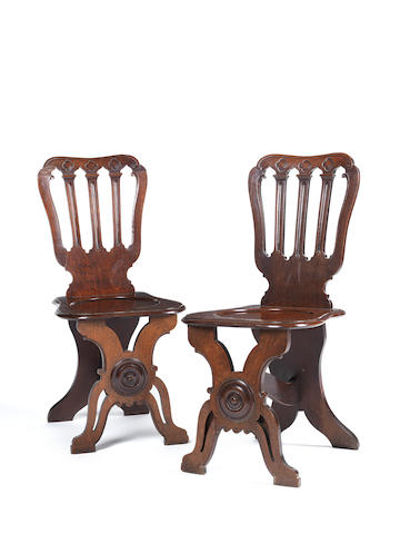 A pair of George III mahogany hall chairs Linnell??, in the Gothick taste