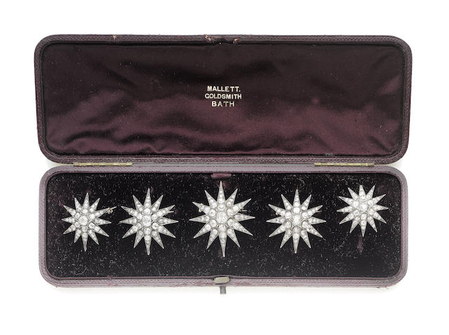 Five diamond star brooches, (5)