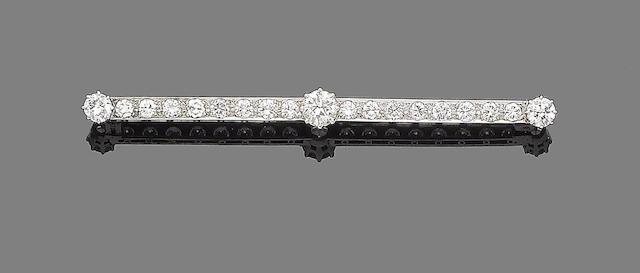 A diamond bar brooch
