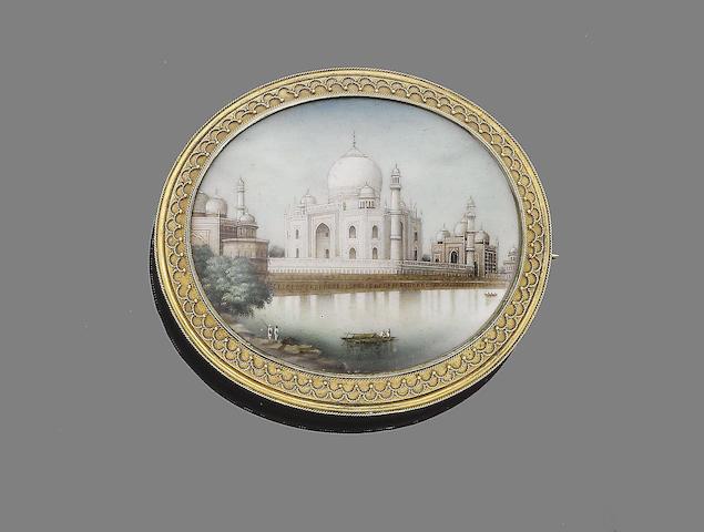 An ivory miniature brooch/pendant,