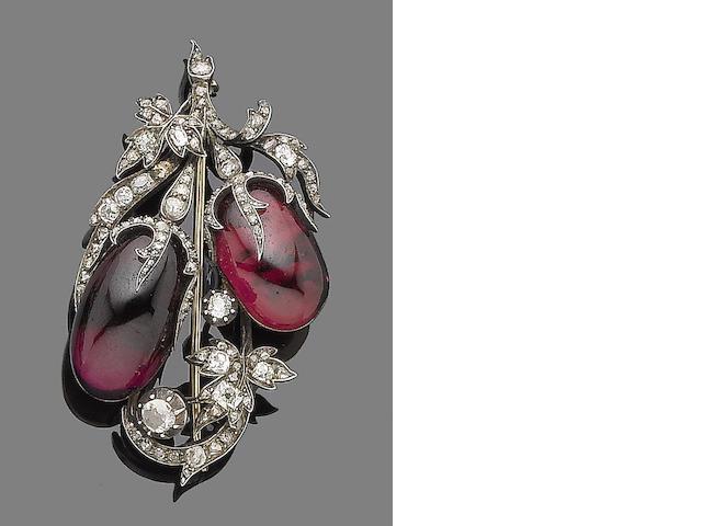 A garnet and diamond brooch,